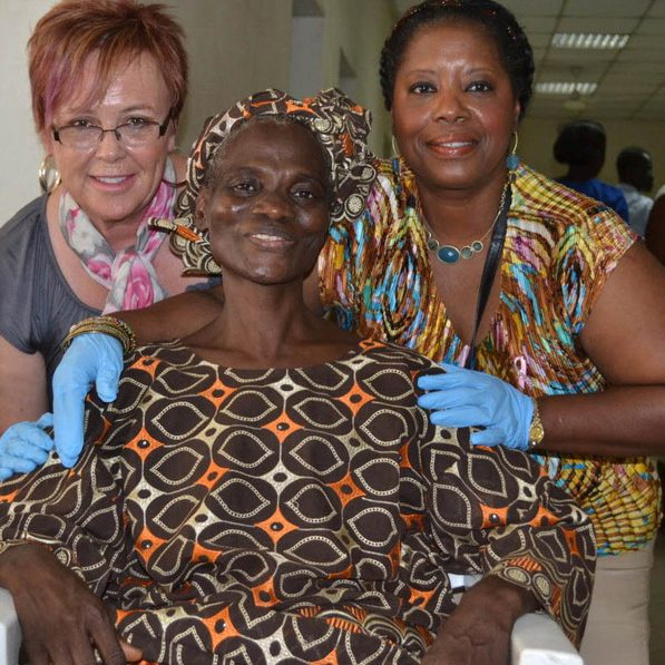 Courage to Dare Foundation's trip to a cancer clinic in Nigeria. Left to right, Jean Schmitz (red hair), Nigerian cancer patient, and Bonnie Anderson.  ---- CREDIT: Courage to Dare Foundation